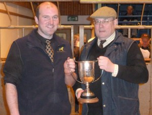 JUDGE LIAM MUIR PRESENTS THE SUPREME CHAMPION TROPHY TO BALFOUR BAILLIE