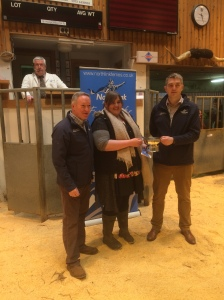 CHRISTINA COPLANDS HEIFER WON THE BEST OVER WINTERED ANIMAL PICTURED HERE WITH SPONSORS NORTHLINKS STUART GARRETT AND KRIS BEVAN